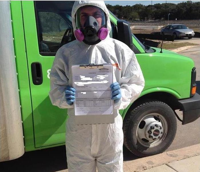 servpro employee holding mold certification