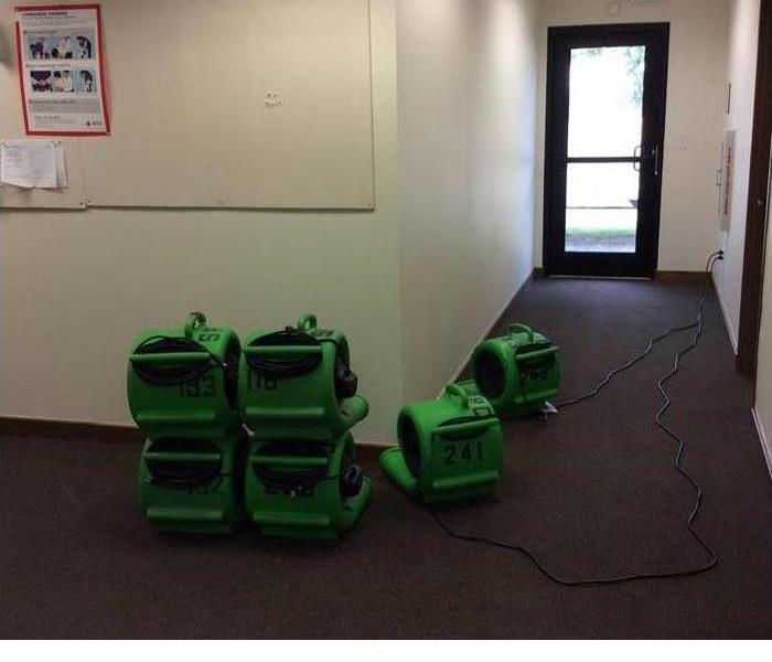 stacked servpro equipment after the area has been dried