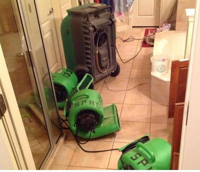 servpro drying equipment on the kitchen floor